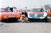 [John Powers with the #71 K&K Insurance Daytona and the #7 Stott SuperBird]