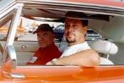 [Sean Machado (driving) and Chrysler engineer George Wallace]