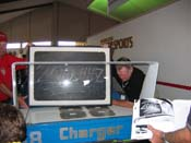 [Buddy Baker with the pit board that was used to document his record setting 200.447 MPH run at Talladega]